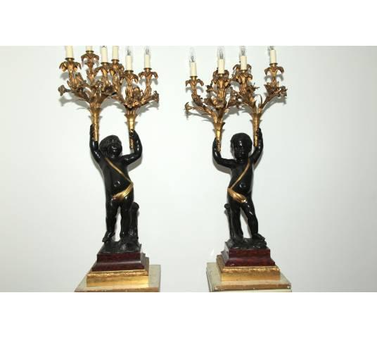 Magnifique paire de portes torchères en bronze doré et bronze patiné d'époque 19 ème