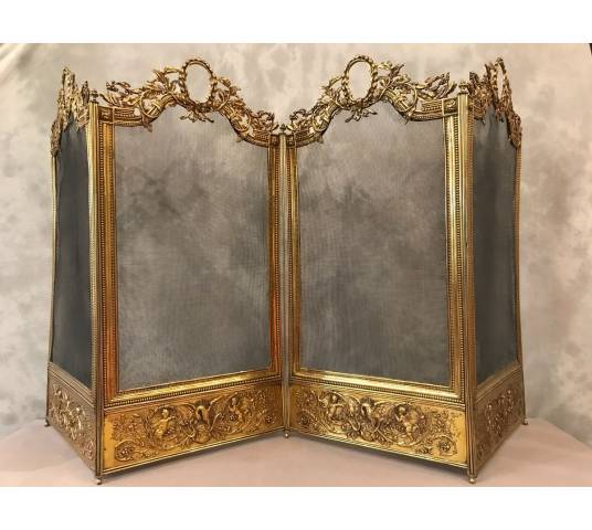 Exceptional firewalls of antique fireplace in bronze and brass in golden varnish 19 th